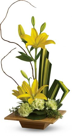 Floral arrangement with yellow lilies