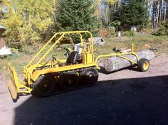 My brothers home made dozer and log trailer