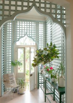 Southern Living is challenging home improvers to rethink lattice. Show here: a breezy side entry to a sunroom with Moorish arches that invite guest in.