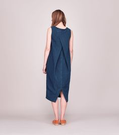 Gently cocoon-shaped dress with cross over pleat at back in real indigo-dyed, Japanese-woven, double-faced herringbone cotton. Wide, boat-ish neck. Split hem at back.