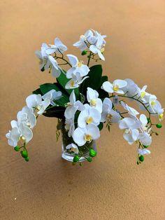 Faux white phaelanopsis orchid arrangement in glass vase. Faux Flower Arrangements, Table Arrangements, Faux Flowers, Silk Flowers, Tropical Design, Floral Design, Floral Wedding, Wedding Flowers, Halloween Decorations