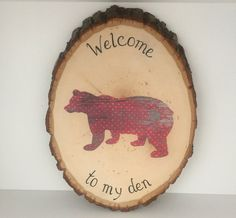 This Bear Wood Slice Art measures approximately 9.75 high, 7 wide, and .75 thick.The bear is cut out of a specialty paper which looks like