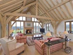 Living Room Interior with Exposed Oak Frame in New Build Farmhouse in West Sussex by Carpenter Oak Ltd Devon