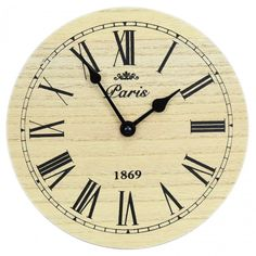 Small Round Wooden Paris Wall Clock Charming traditional design wall clock with roman numerals Elegant Paris 1869 motif Easy to read clock face Lovely small wall clock that will suit a range of rooms