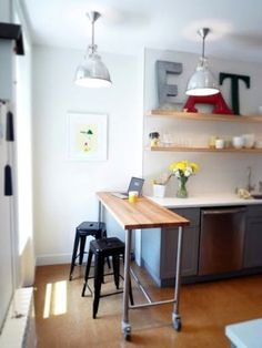 For a small studio, add a mobile bar for eating and added counter space. The wheels make it easy to re-position.