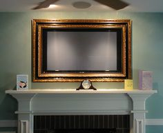 Picture framed television - great idea!