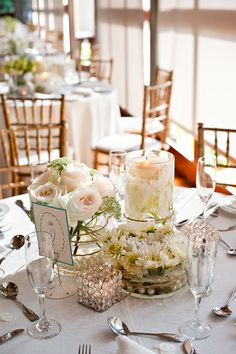 Centerpieces: while I dont totally like their flower choices or the ...
