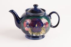 Moorcroft Pansy Teapot ... pansy flowers on high gloss dark body, marked 'Moorcroft Made in England', c. 1910-1920, ceramic, UK