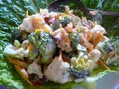 Broccoli and Cauliflower Salad with Bacon.  I substituted tomatoes for the celery and raisins.  I also used Hidden Valley Ranch for the dressing.