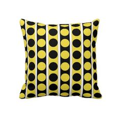 Black, white, yellow stripes and polka dots print pillow.