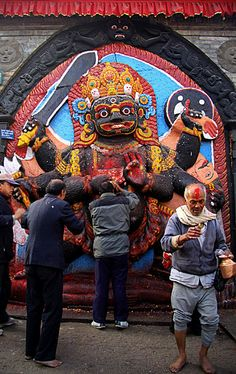 This is Kal Bhairab in de background located in Kathmandu Darbar Square. Every morning, devotees visit this place to worship as well as other temples around de Darbar Square (Ancient Palace). Kal Bhairab is de fierce manifestation of Lord Shiva associated with annihilation. He is one of de important deities of Nepal, sacred to Hindus n Buddhists alike. Kathmandu Darbar Square, Bagmati_ Central Nepal