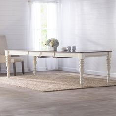 Solid pine is carved with elegant details to create the Dalton Dining Table. Featuring four stunning turned legs and a contrasting dark tabletop, this table include two extension leaves so you can seat up to eight.