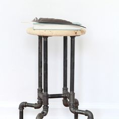 DIY Industrial Pipe Stools - easy to assemble and super unique! Adds the perfect industrial touch to any room.