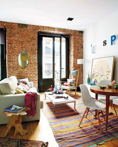 Cozy Tiny Apartment In Madrid With A Youthful And Chic Interior - brick wall, colors, light and airy yet structured