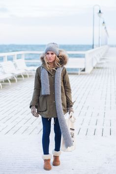 Winter outfit idea with fur parka, fur boots, jeans, and mittens #fashion #style #winter