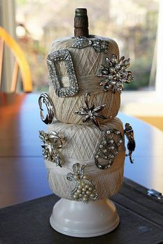 Nice way to show off vintage jewelry.  This could also be a cute lamp!
