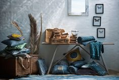 small vintage suitcase, light, textured walls