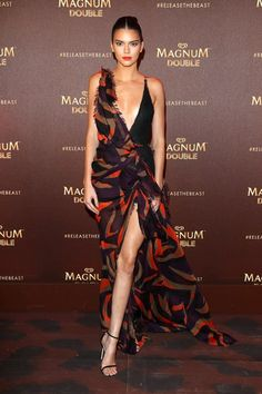Kendall Jenner stuns in an asymmetrical Versace half-gown at party for Magnum Doubles. Get more details!