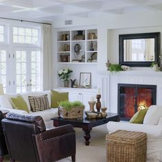 The room seems too white but I like the furniture arrangement and the architecture.