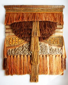What a lush wall hanging! Love the gray loops and huge tassels on the bottom.