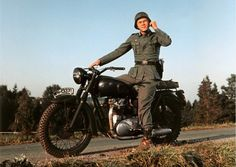 Triumph motorcycles at the movies - in pictures Former bike mechanic Steve McQueen was synonymous with Triumph. The bike that he rides in 1963's The Great Escape is a modified Triumph TR6 Trophy which was painted black to resemble a German BMW. Bud Ekins who actually performs the famous barbed wire leap stunt, was a Triumph dealer