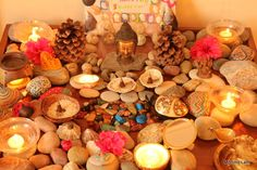 Meditation garden/nature table with flowers, painted rocks, candles, incense