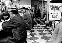 The civil rights movement  -  Black students sit in at a whites-only lunch counter. Nashville, Tennessee, February 1960.