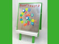 This double sided magnet board offers the opportunity for children of all ages to manipulate gears of different sizes. Children love to get competitive and see how many gears they can get moving with the battery-operated driver