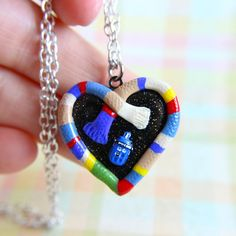 I had some leftover Fourth Doctor scarf, so I decided to try out making a locket. I love how it came out!! The micro Tardis, and the black sparkly clay to look like stars. Everything about it is so...