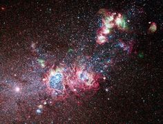 The dwarf galaxy NGC 4214 is ablaze with young stars and gas clouds. Located around 10 million light-years away in the constellation of Canes Venatici (The Hunting Dogs), the galaxy's close proximity, combined with the wide variety of evolutionary stages among the stars, make it an ideal laboratory to research the triggers of star formation and evolution.