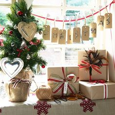 Keep wrapping simple but beautiful, using plain brown paper livened up with striped ribbons and feather decorations.