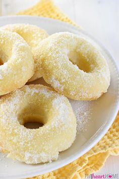 Lemon Sugar Baked Donuts ~ light, citrusy, and generously coated in a crunchy, lemon-zest infused sugar.the perfect sunny treat for breakfast or dessert! Köstliche Desserts, Delicious Desserts, Dessert Recipes, Yummy Food, Lemon Recipes, Sweet Recipes, Baking Recipes, Baked Donut Recipes, Baked Donuts