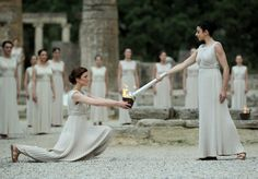 The #Olympic torch is lit by an actress dressed as the High Priestess using a parabolic mirror to reflect the rays of the sun. The ceremony organised by the Hellenic Olympic Committee (HOC) to light the Olympic Flame was held today inside the Temple of Hera at the historic ruins of the home of the ancient Olympic Games. #Greece