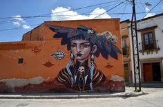 Un distrito olvidado cambia su historia a través de murales y arte urbano.