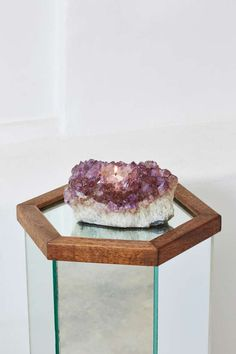 Get your apartment in rock solid form. The Rock Solid Candle Holder is an amethyst crystal cluster with cylindrical candle opening. Under-padding to protect surfaces. Perfect anywhere in the house. Rock on, ladies.