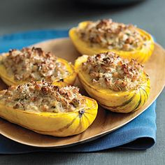 Nut-Stuffed Delicata Squash Need a cold-weather vegetarian main dish? Some kind of alchemy takes place with the onions, sage, and nuts to create a distinctly sausagelike flavor. Nut Recipes, Fall Recipes, Wine Recipes, Cooking Recipes, Recipies, Vegetarian Main Dishes, Vegetarian Recipes, Healthy Recipes, Healthy Eats