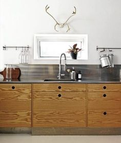 Stainless shows its versatility as it's perfect in a rustic kitchen with plywood countertops, from Residence.