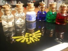 Legend of Zelda bottle necklaces: Fairy in a bottle, Triforce, Milk bottle, and potions.