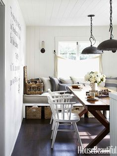 Use a banquette for extra seating at the dinner table and as an extra guest bed. Designed by Erin Martin and Kim Dempster. housebeautiful.com #dining_room #decorating_shortcuts #trestle_table
