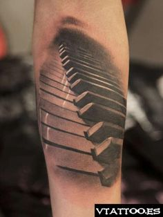Piano tattoo - The only tattoo I will get for a lost loved one. A piano for my grandfather, my best memories of him were playing the piano with him and singing with him at church and in his living room and with Elias also, he is deeply missed.