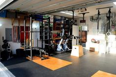 Here is another angle of Tim's garage gym. Again, as you can see it's very well done. I dig the flooring a lot, how the platform is seamless with the entire floor Crossfit Garage Gym, Home Gym Garage, Diy Home Gym, Gym Room At Home, Basement Gym, Garage Studio, Bodybuilder, Gym Setup, Dream Gym