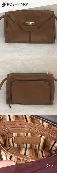 Leather cross body purse Pre owned leather Tignanello crossbody purse in good condition. The leather strap does have loose thread (seen in picture). There are a few small scuff marks on bottom of the purse. Measurements: 10 inches wide, 7 inches tall2 inches wide. Smoke and pet free house Tignanello Bags Crossbody Bags