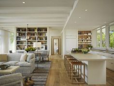 On the following photos we present you 17 space-saving tricks to combine kitchen and living room into a functional gathering place — perfect for work, rest and play. Open concept kitchen- living room