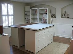 use two matching dressers as a base for a sewing table, providing lots of storage with clean lines