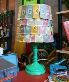 'This adorable, whimsical lamp was DIYed by Beth at Green Cricket Salvage using money from a circa 1930s Monopoly game.'