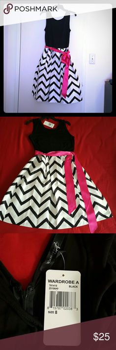 Beautiful Black/white Dress, Size 8, knee length Beautiful Black/White Dress, Size 8, knee length, Back zip, Pink waist tie, Material: polyester and spandex. Never worn. Has tags. Wardrobe A Dresses Midi