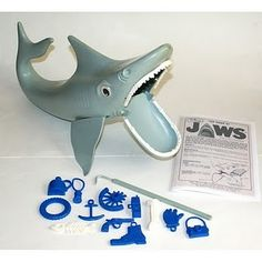 JAWS game. I wasn't old enough to enjoy playing this when was popular. It's like Operation and Concentration smooshed together. Must find one.