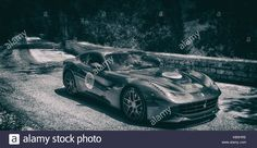 Download this stock image: FERRARI F12 BERLINETTA 2015 on an old racing car in rally Mille Miglia 2017 the famous italian historical race (1927-1957) on May 19 2017 - KB5HRE from Alamy's library of millions of high resolution stock photos, illustrations and vectors.
