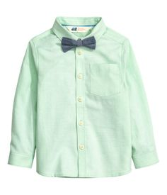 Light green. Long-sleeved shirt in woven cotton fabric with a chest pocket and matching bow tie or tie.