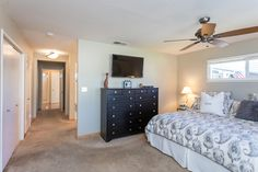 The master suite enjoys plenty of closet space and an open vanity to the attached full bathroom.